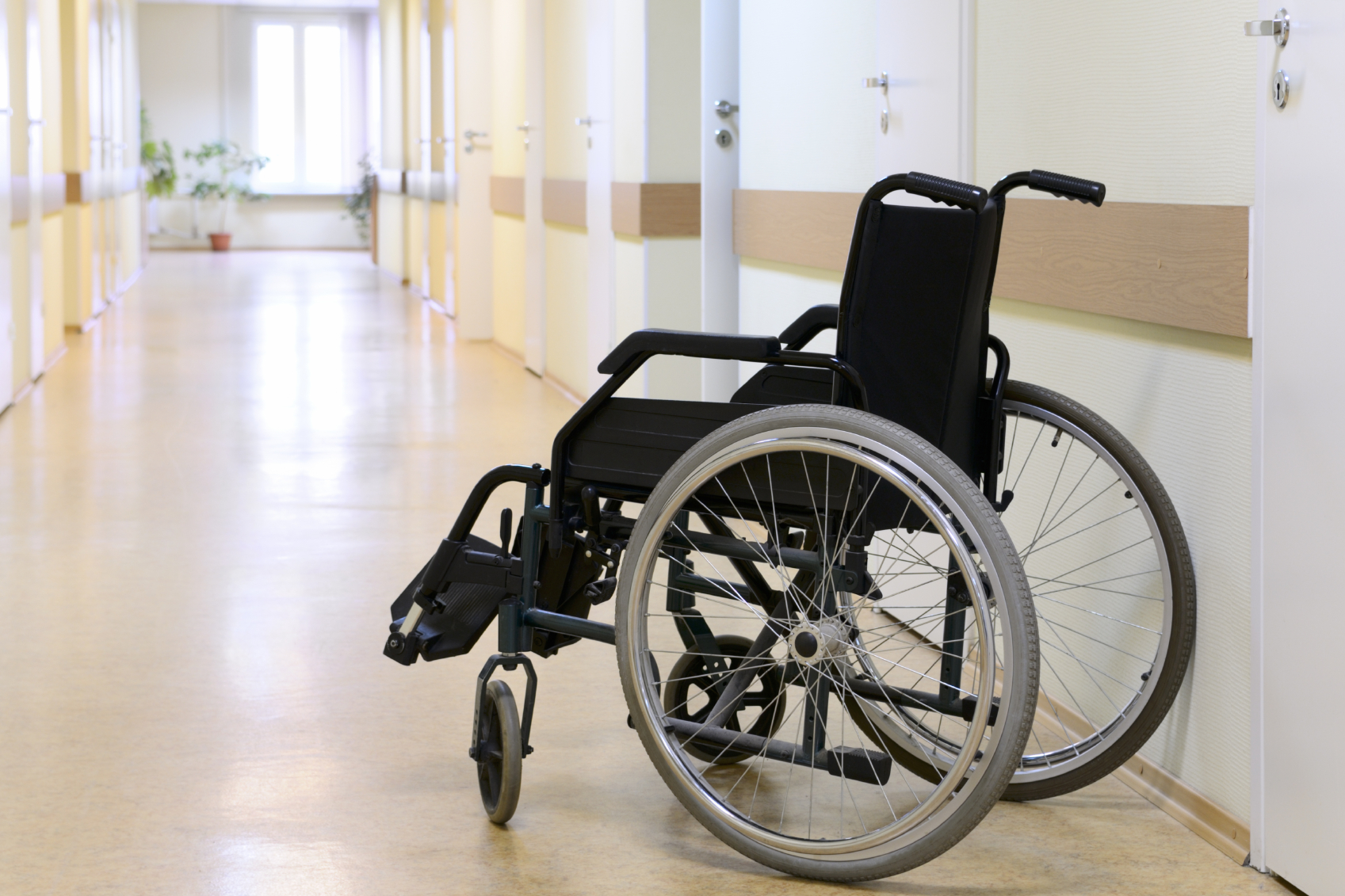An empty wheelchair in a nursing home signals neglect