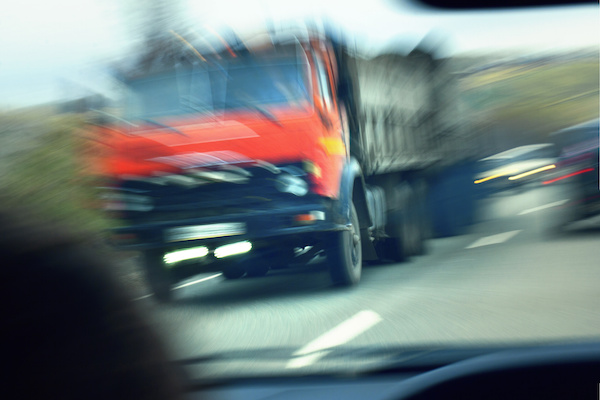 Truck speeding by in an opposite highway lane