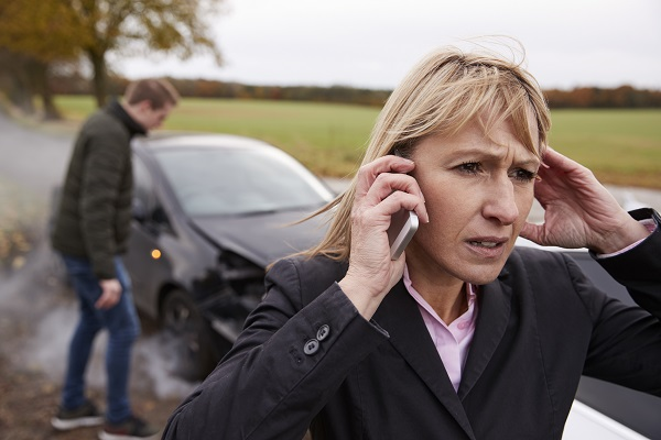 Woman Calling Car Accident Lawyer After Being Hit by an Uninsured Driver